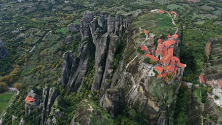 Aerial view of historical orthodox monasteries on the top of meteors cliffs, Kalampaka Kalabaka Kalambaka, Greece. Beautiful mountainous landscape with rocky cliffs.