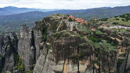Aerial view of historical orthodox monasteries on the top of meteors cliffs, Kalampaka Kalabaka Kalambaka, Greece. Beautiful mountainous landscape with rocky cliffs.