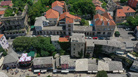 Aerial view of Old Town Mostar, medieval houses and market near Stari Most, old bridge on Neretva river. Summer sunny day. Imagens - 139967240