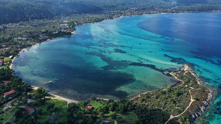 Aerial view of Halkidiki landscape, Vourvourou sandy beach, lagoon with rocks, Kavourotripes beach, Sithonia peninsula. Greece. Imagens