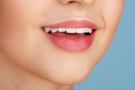 augmentation: Perfect natural lip makeup. Close up macro photo with beautiful female mouth. Plump full lips. Close-up face detail. Perfect clean skin, light fresh lip make-up. Beautiful spa tender lip