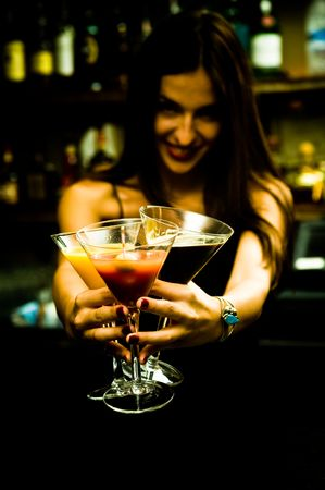 bartender: A young female bartender, photographed at work. Stock Photo