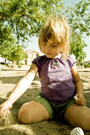four year old: A four year old girl, playing outside. Stock Photo