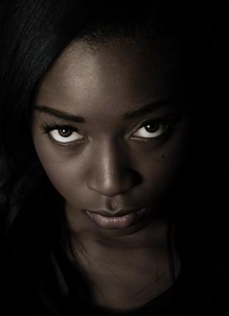 femme noir sexy: Une jeune femme, photographi�es en studio. Banque d'images