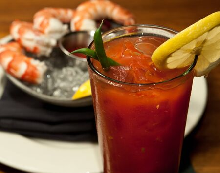 A Bloody Marry with a shrimp cocktail, shot at a French restaurant.