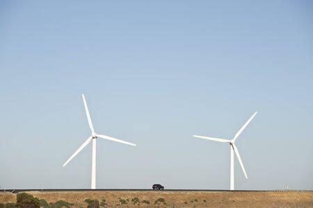 Wind Turbine farms in various locations Foto de archivo