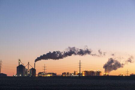 Ethanol factory early morning smoke rising Foto de archivo