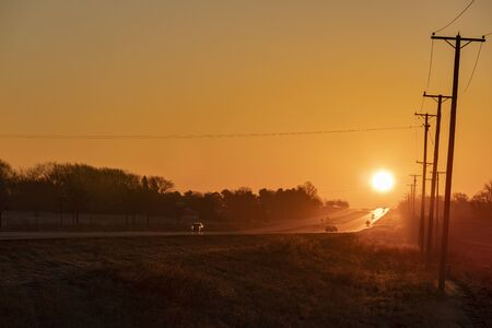 Early morning sunrise over country road