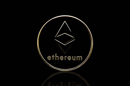 Ethreum crypto currency coin in isolated black background. Foto de archivo