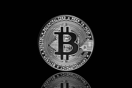 Bitcoin crypto currency coin in isolated black background.