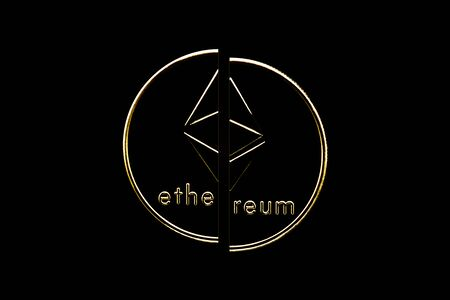 Ethereum crypto currency coin in isolated black background cut in half.
