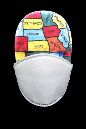 Health mask depicting global pandemic breakout in the US Stock fotó