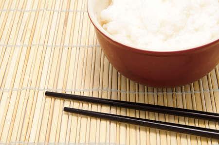makki: chopsticks and tureen with rice on bamboo tray Stock Photo
