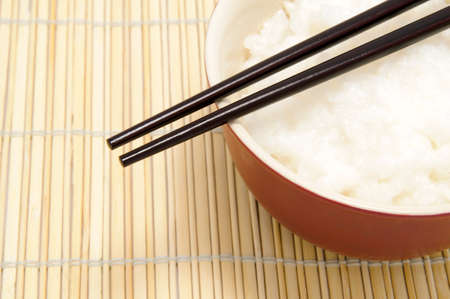 soysauce: chopsticks and tureen with rice on bamboo tray Stock Photo