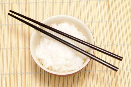 tekka: chopsticks and tureen with rice on bamboo tray Stock Photo
