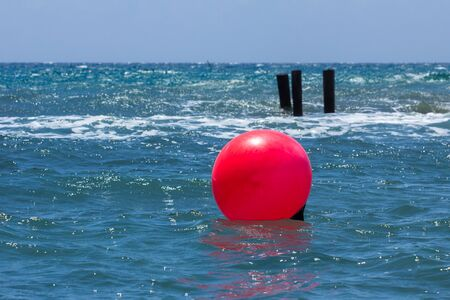 seascape with red ball on the waves and horizon Stock Photo