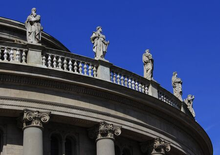 decorative balcony: elements of building and statues on balcony