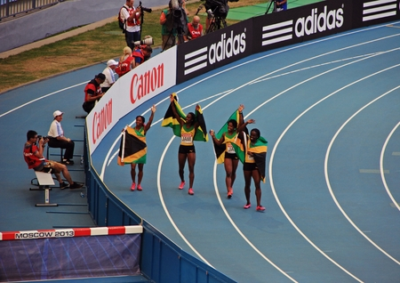world championships: champion Shelly-Ann Fraser-Pryce and others with flags, XIV IAAF World Championships, Moscow, 2013