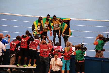 world championships: champion Usain St. Leo Bolt and others with flags, XIV IAAF World Championships, Moscow, 2013