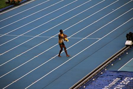 world championships: Usain St. Leo Bolt dancing on the treadmill squatting, XIV IAAF World Championships, Moscow, 2013