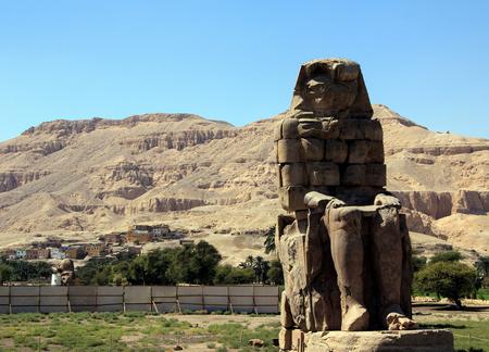The Colossi of Memnon. Right massive stone statue of the Pharaoh Amenhotep III. Stock Photo