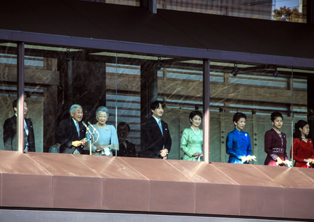 Members of the imperial family on the balcony of the palace are greeted by the people in the square in Tokyo. New years of the family of the emperor of Japan Akihito.