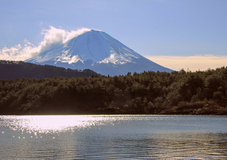 Winter landscape with Mount Fuji, forest and lake. Nature of Japan. Famous and beautiful places in the world.