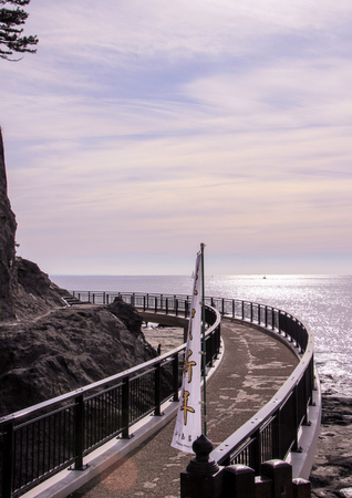 an artificial road along the cliffs and the Pacific Ocean in Kamakura. Nature of Japan.
