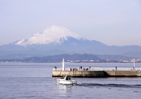 A pier with cars on Mount Fuji background. Landscapes of Japan. Kamakura, Japan, 01062013.