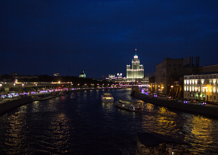 09032017, Moscow, Russia. Moscows cityscape tonight. Sights of Moscow with river and buildings in the night.