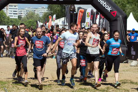 2018.05.27, Moscow, Russia. Festival of fitness about Reebok in Moscow park. Runners close up on start line at Festival. Sport lifestyle in the city. Editorial