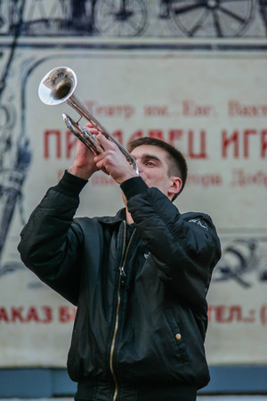 2010.04.10, Moscow, Russia. a young man playing a trumpet on the walking street Arbat.