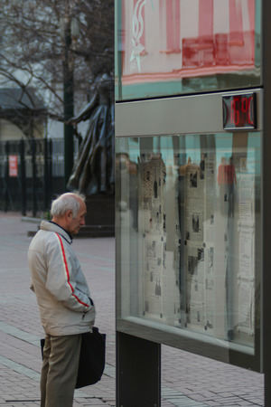 2010.04.10, Moscow, Russia. An old man reading newspaper on the street. Locals people of Moscow.