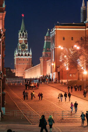 2010.04.10, Moscow, Russia. Tourists walking around Red Square tonight. Cityscape of Moscow tonight. Saint Basil Cathedral tonight.
