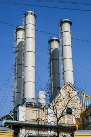 2010.04.11, Moscow, Russia. Factory pipes on background of blue sky. Concept of pollution atmosphere.