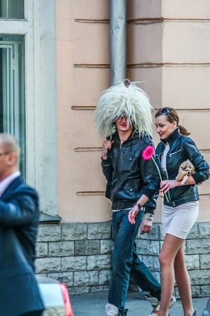 2010.04.11, Moscow, Russia. A young man wearing a woolen hat and young girl walking down the street.