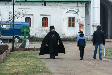 2010.04.17, Istra, Russia. fat priest in black anr