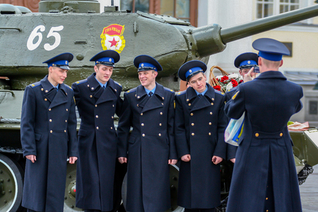 2010.04.18, Moscow, Russia. Young cadets are photographed on the background of the tank. Attractive Russian guys. Editorial