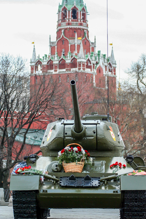 2010.04.18, Moscow, Russia. Tank covered by flowers on Moscow of Moscow Kremlin. Unusual decorative elements on the Moscow street. Editorial