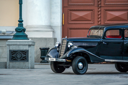 2010.04.18, Moscow, Russia. An old vintage black car on background of gates. Editorial