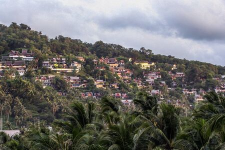 Landscape of the village on the hillside. Travel around Thailand. Architecture of Thailand, blur and grain effect. Banco de Imagens