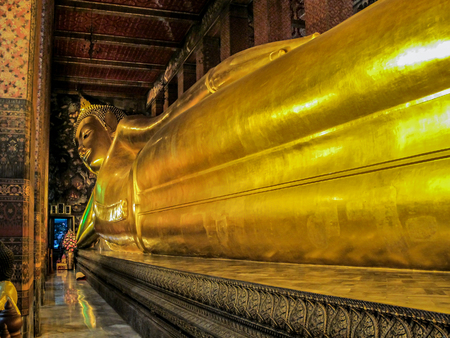051411, Bangkok, Thailand. Golden statue in Wat Pho. Interior of the Temple of the Reclining Buddha. Famous sights of Bangkok.