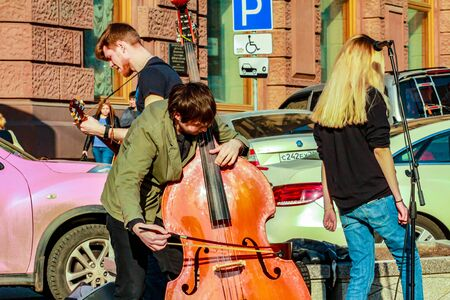2015.04.12, Moscow, Russia. Street musicians at spring day. Trio band of young artists at the street performance. Editorial