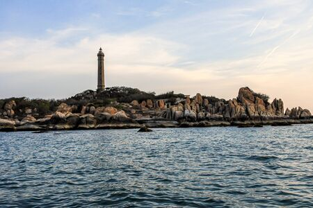 Travel around Asia. seascape with lighthouse and plants on the coast in the evening, Vietnam
