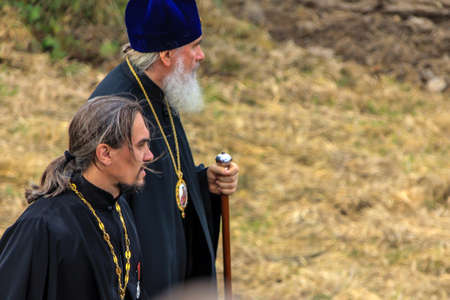 10.21.2012, Maloyaroslavets, Russia. two of Christian Orthodox priests walk along the field.