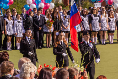 09/01/2015, Maloyaroslavets, Russia. a group of people (parents and children) at a holiday on the first school day.