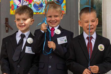 09/01/2015, Maloyaroslavets, Russia. Three schoolboys having fun at first day at school. Boy's group portrait.