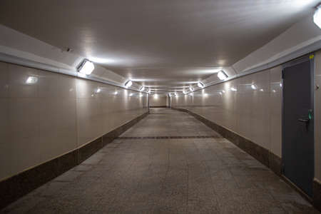 Perspective of the interior of the underpass. Moscow cityscape.