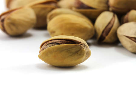 Pistachios on a white background photo
