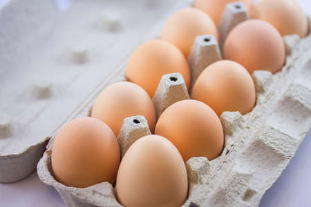 eggs in a carton on a white background Stock Photo